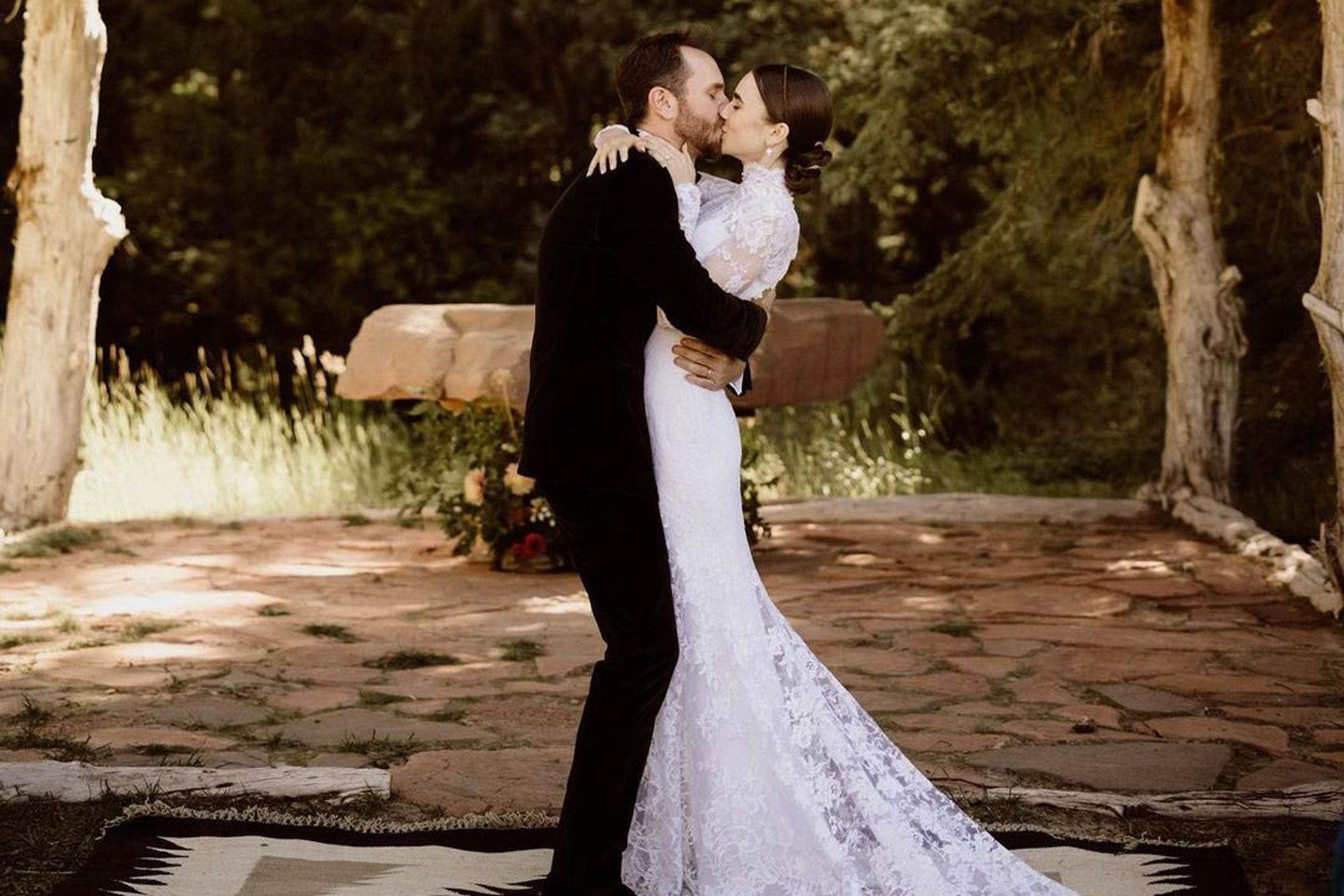 lily collins and husband sharing kiss
